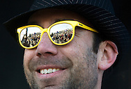 NEWS&GUIDE PHOTO / PRICE CHAMBERS.Jet Black Ninja Funkgrass Unit mandolin player Tim Farris reflects a view of the audience in his super cool Rossignol sunglasses as the band plays Saturday at the Jackson Hole Mountain Festival.