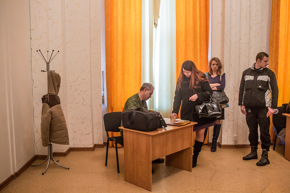 Eduard Basurin, left, the deputy defense minister of the Donetsk People's Republic, signs papers following his daily news conference on Tuesday, March 22, 2016 in Donetsk, Ukraine.