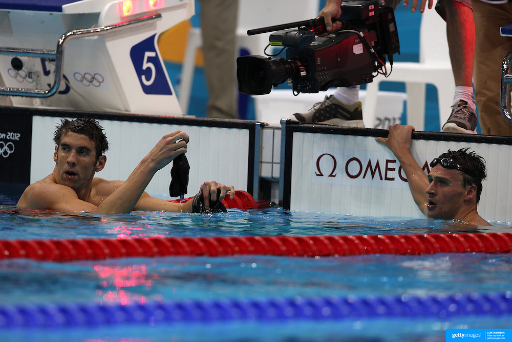 Michael Phelps USA, (left)  and Ryan Loche, USA, after competing against each other in the Men's 200m Individual Medley semi final at the Aquatic Centre at Olympic Park, Stratford during the London 2012 Olympic games. London, UK. 1st August 2012. Photo Tim Clayton