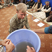 Jon Rose and Christian Troy of Waves For Water give demonstrations on setting up water filtration systems to Army personnel and Afghan Officials of the Nari district in a shura held on Forward Operating Base Bostick, Kunar Province of Eastern Afghanistan.
