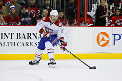 Jan 2, 2009; Newark, NJ, USA; Montreal Canadiens left wing Max Pacioretty (67) shoots on New Jersey Devils goalie Scott Clemmensen (35) and scores his first NHL goal during the first period at the Prudential Center.