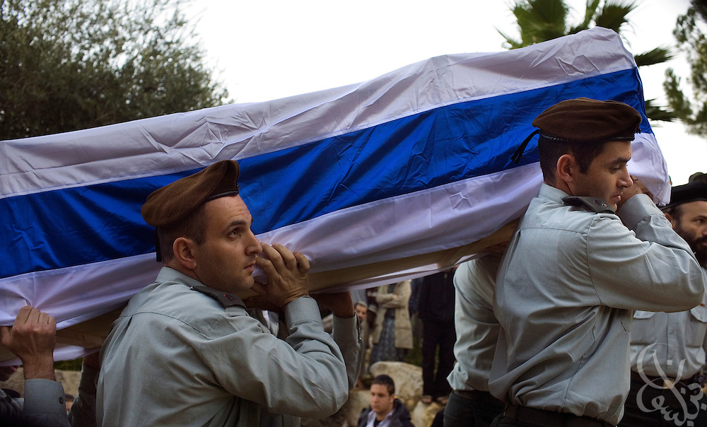Israeli soldiers carry the flag-draped coffin of Major Dagan Vertman, 32, who died in an operation in the Gaza Strip Monday, during his funeral at the Mt. Herzl cemetery in Jerusalem, Tuesday, Jan. 6, 2009. Vertman and two other soldiers were killed when an  Israeli tank mistakenly fired on their position in an apparent friendly-fire incident according to the Israeli army.