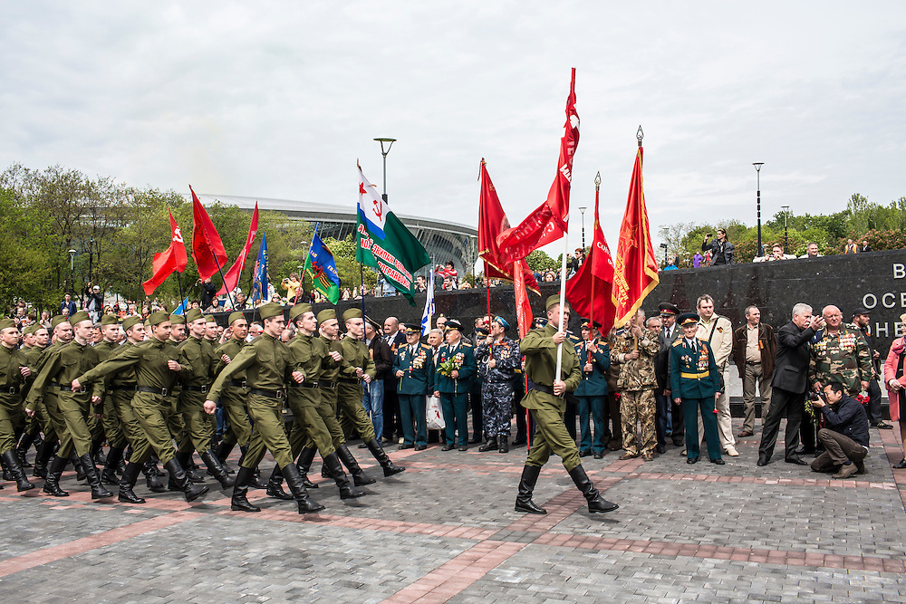 DONETSK, UKRAINE - MAY 9: Ukrainian soldiers march during a ceremony commemorating victims of World War II on the Victory Day holiday on May 9, 2014 in Donetsk, Ukraine. Tensions in Eastern Ukraine are high after pro-Russian activists seized control of at least ten cities and ahead of the Victory Day holiday and a planned referendum on greater autonomy for the region. (Photo by Brendan Hoffman/Getty Images) *** Local Caption ***