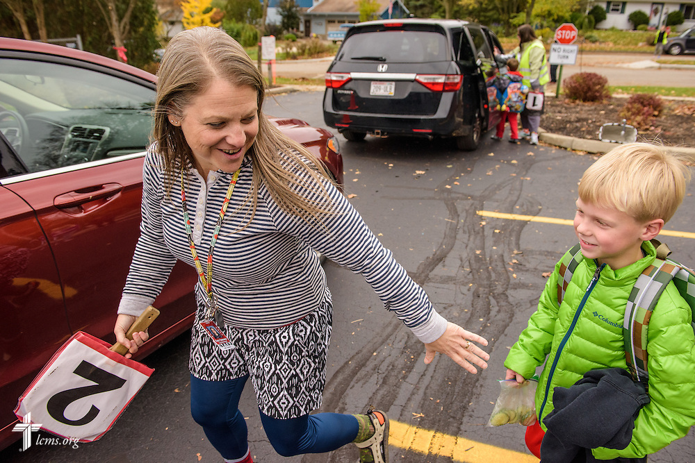 Wendy Seban guides a student to his parent's car following at dismissal on Thursday, Oct. 27, 2016, at First Immanuel Lutheran School in Cedarburg, Wis. LCMS Communications/Erik M. Lunsford