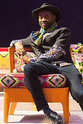 Bonhams, London, February 29th 2016. Fashion designer and stylist Samson Soboye sits on the chair he created during a photocall for &quot;Sitting Pretty&quot;, featuring unique, hand painted and upholstered chairs made by 30 celebrities and artists, at Bonhams ahead of their auction in support of a leading AIDS charity, CHIVA Africa.<br /> &copy;Paul Davey<br /> FOR LICENCING CONTACT: Paul Davey +44 (0) 7966 016 296 paul@pauldaveycreative.co.uk