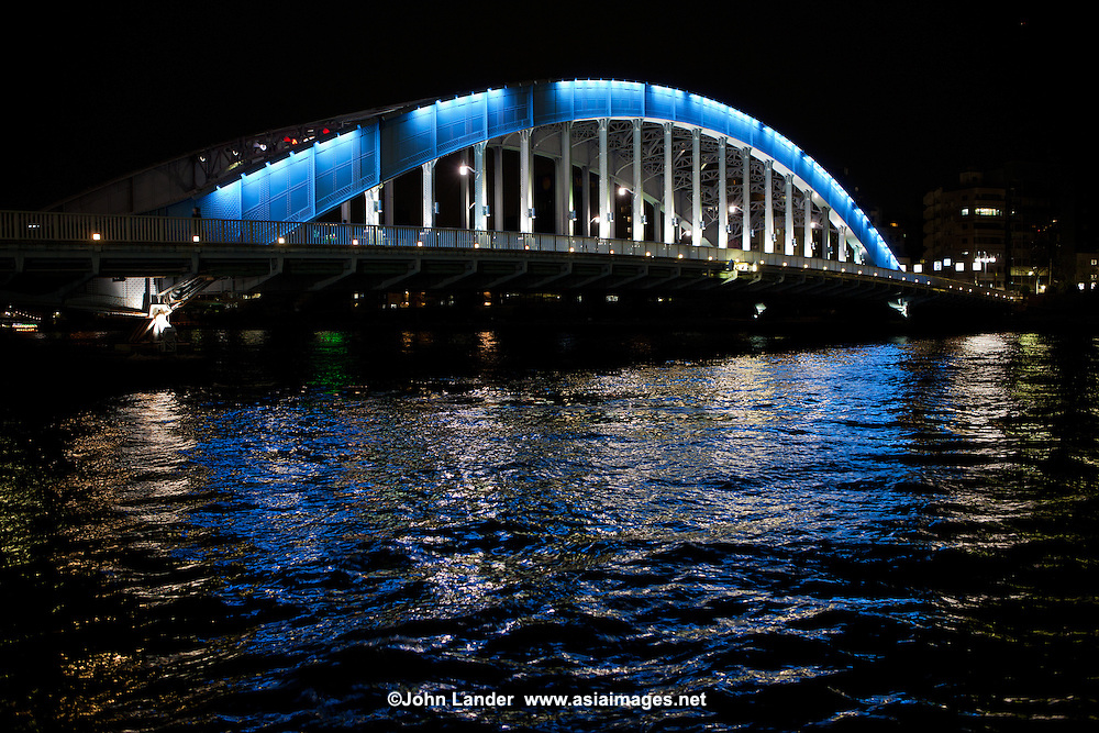 "The Eitai-bashi Bridge or just Eitai Bridge dates from 1924, replacing a bridge built in 1696.  The Sumida River or Sumida-gawa as it is known in Japanese, is a river which flowing through Tokyo. It branches from the Arakawa River and flows into Tokyo Bay. Its tributaries include the Kanda and Shakujii rivers. What is now known as the ""Sumida River"" was previously the path of the Arakawa River, however towards the end of the Meiji period the rivers were diverted from the main flow of the Arakawa to prevent flooding."