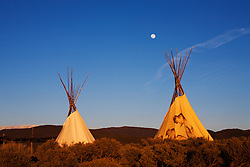 Moonrise over a pair of teepees near Taos, New Mexico.