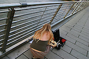 England, London: Charing Cross Station. busker on Golden Jubilee Bridges England, London:
