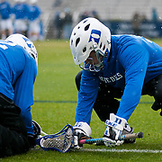 Duke midfielder Greg DeLuca #32 and Duke midfielder Jack Rowe #35 go through faceoff drills. The third-ranked Fighting Irish defeated sixth-ranked Duke, 13-5, in men's lacrosse action on a snowy Saturday afternoon at Koskinen Stadium in Durham, N.C.
