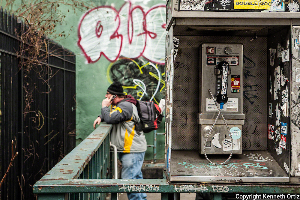 I came across this image on Houston street over by 2nd Avenue in Manhattan. Its interesting how technology influences our interaction with our environment. About thirteen years ago it would have been a 50/50 toss up running into this guy on the public telephone. The public telephone is fast becoming a thing of the past.