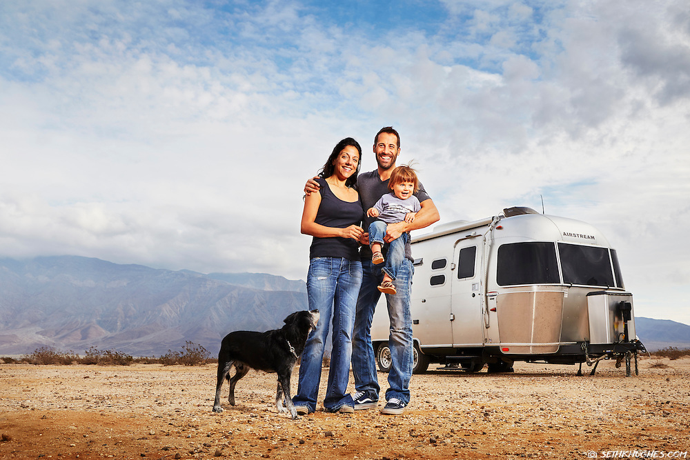 David Couillard and his young, nomadic family stand outside their Airstream trailer while camping in the Anza Borrego Desert of California.