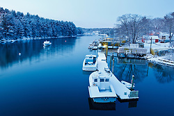 Lobster boats docked on Sagamore Creek in Portsmouth, New Hampshire. Winter.