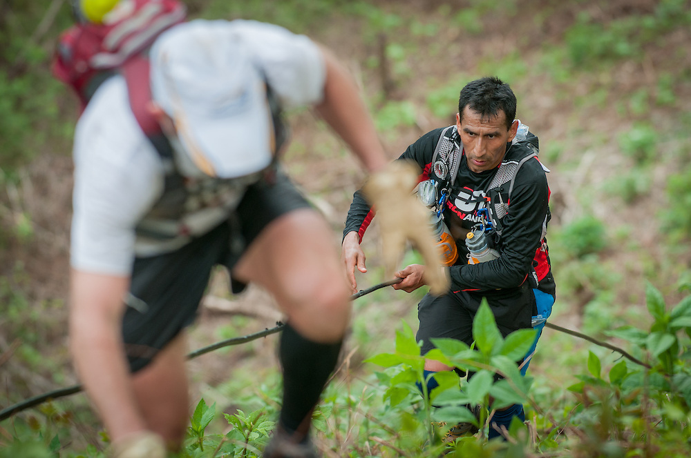 Iso Yucra uses a downed power line to climb Rat Jaw during the Barkley Marathons.