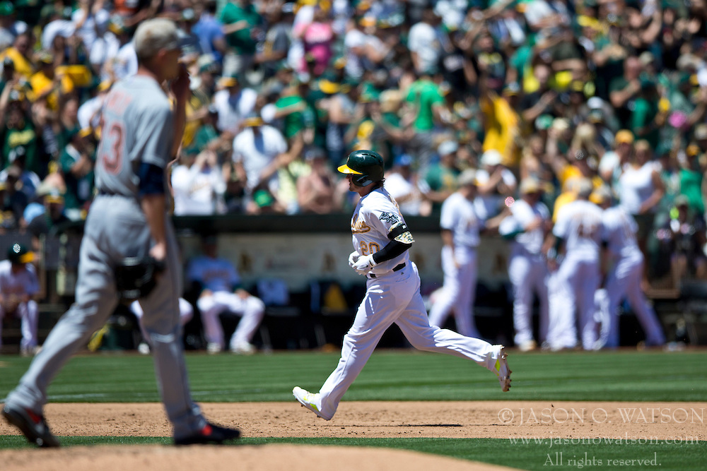 OAKLAND, CA - MAY 26:  Josh Donaldson #20 of the Oakland Athletics rounds the bases after hitting a home run off of Drew Smyly #33 of the Detroit Tigers during the third inning at O.co Coliseum on May 26, 2014 in Oakland, California. The Oakland Athletics defeated the Detroit Tigers 10-0.  (Photo by Jason O. Watson/Getty Images) *** Local Caption *** Josh Donaldson; Drew Smyly