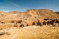 Madison Buffalo Jump State Park, Montana, southeast of Three Forks, couple hiking