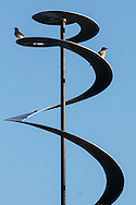 Sugar Loaf, New York - Two birds perch on a spiral aluminum sculpture by Julius Medwin at the Seligmann Center on Sept. 22, 2016.