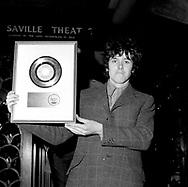 "Donovan 1967 with ""Sunshine Superman"" US Gold Record.© Chris Walter."