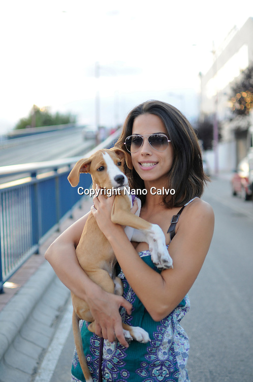 MR Young attractive spanish girl holding her puppy