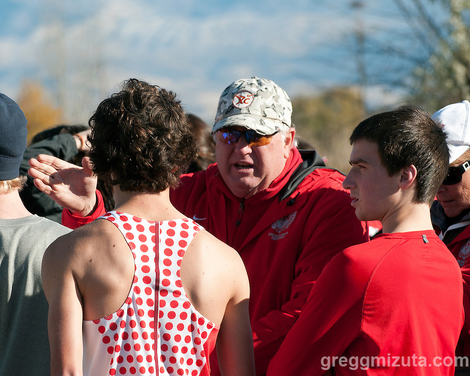 Boise High head coach Dave Mills gives instructions before the start of the NXN Northwest Regional boys championship race at Eagle Island State Park on November 12, 2011.