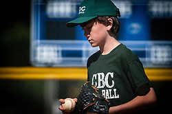 Young boy playing baseball.