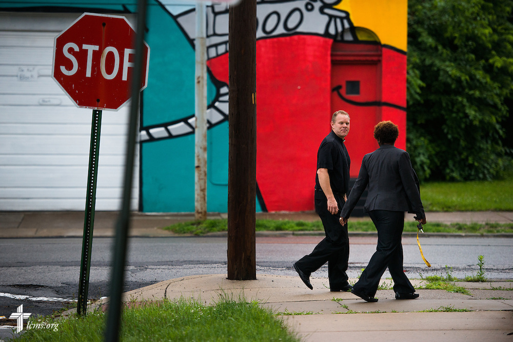 The Rev. Peter M. Burfeind, new domestic missionary and campus pastor at the University of Toledo, surveys a neighborhood with community advocate Alicia Smith on Thursday, July 9, 2015, in Toledo, Ohio. LCMS Communications/Erik M. Lunsford