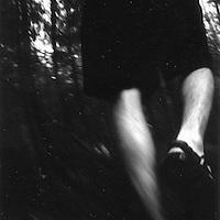 Hiker in water, vertical pan