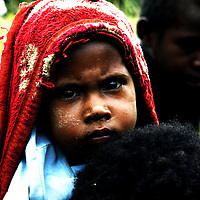 MAMIT,APRIL-30 :  a mother carries her sick child Mamit village..  . Logging is one of the major causes of environmental destruction in West Papua. As Indonesia's own forest resources decline, it has turned its attention to West Papua. Indonesia's forest practices generally have little or no attention paid to the environmental impact of logging. Many of the indigenous people of West Papua are threatened as vast tracts of land have been granted as concessions to timber companies, a practice which is having severe social and physical consequences. . The island of New Guinea is one of the most biologically diverse in the world. There are species of flora and fauna in common with Australia, such as some marsupials, the bird of paradise and eucalyptus trees. Numerous species, unique to the island, are threatened by logging and other development projects. . Second only to the Amazon, the island of New Guinea has one of the largest tracts of tropical rainforest left in the world. West Papua's forests, rich in bio-diversity, account for approximately 34.6 million hectares or 24 per cent of Indonesia's total forested area of 143 million hectares. Over 27.6 million hectares of forest in West Papua have been designated as production forest.