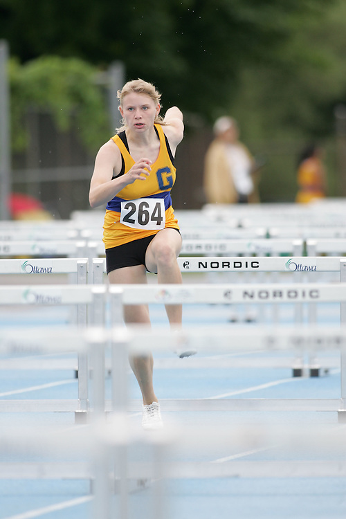Emilie Halle competing in the sprint hurdles at the 2007 Ontario Legion Track and Field Championships. The event was held in Ottawa on July 20 and 21.