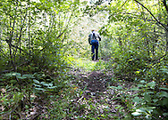 Walking down a brush covered trail in Waushara County Wisconsin.