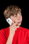 Young Boy Talking on a Apple Iphone 3G - 2009
