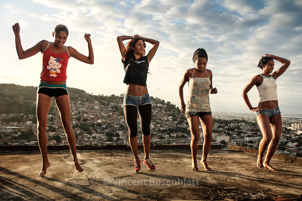 """Funk on the rooftops. Elaine, Cris, Aninha & Dani, of the group """"Tchutchucas"""", are rehearsing their new choreography on the rooftop of Elaine's house in the Vila Cruzeiro favela, Rio de Janeiro. Their spicy rap responds to the MCs'macho attitude."""