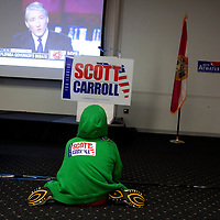 TAMPA, FL -- October 25, 2010 -- JJ Feiler, 10, of Brandon watches a debate with Republican candidate for governor Rick Scott in Tampa, Fla., on Monday, September 25, 2010.  Scott was kicking off his final week of campaigning in the heated race for Florida Governor against Democrat Alex Sink.