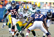 .Green Bay Packers' James Starks rushing is tackled by Chicago Bears' Major Wright in the 1st quarter. .The Green Bay Packers traveled to Soldier Field in Chicago to play the Chicago Bears in the NFC Championship Sunday January 23, 2011. Steve Apps-State Journal.
