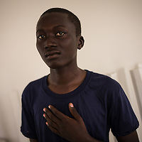 A migrant from Senegal housed at the Zagare holding center. Almost 200 hundres lives in the center