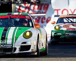 LONG BEACH, CA - APR 16: American Le Mans team Black Swan Racing Leads Magnus Racing Team during the American Le Mans Series race at the 37th Toyota Grand Prix of Long Beach 2011. Photo by Eduardo E. Silva