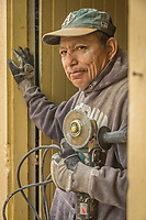 Santa Rosa resident and construction worker Daniel Salgado works on a remodel project on Myrtle Street in Calistoga.