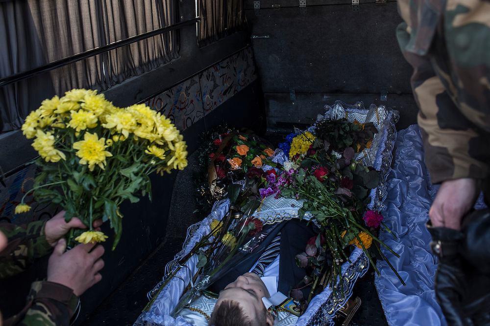 KIEV, UKRAINE - JANUARY 26: The body of Mikhail Zhiznevsky, 25, an anti-government protester who was killed in clashes with police, rests in the back of a hearse following a memorial service in his honor on January 26, 2014 in Kiev, Ukraine. After two months of primarily peaceful anti-government protests in the city center, new laws meant to end the protest movement have sparked violent clashes in recent days. (Photo by Brendan Hoffman/Getty Images) *** Local Caption *** Mikhail Zhiznevsky