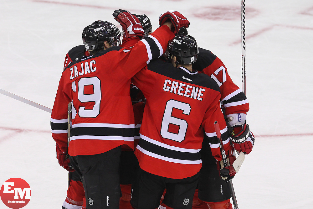Feb 7, 2013; Newark, NJ, USA; The New Jersey Devils celebrate a goal by New Jersey Devils defenseman Andy Greene (6) during the third period at the Prudential Center. The Devils defeated the Lightning 4-2.