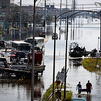 NEW ORLEANS, LA - September 4, 2005:  Rescue workers, armed with pistols and rifles, stage at the edge of flooded New Orleans on Sept, 4, 2005 in New Orleans following the destruction caused by Hurricane Katrina. The view is looking down Airline Way, a large boulevard the dissects the city. (Photo by Todd Bigelow/Aurora)