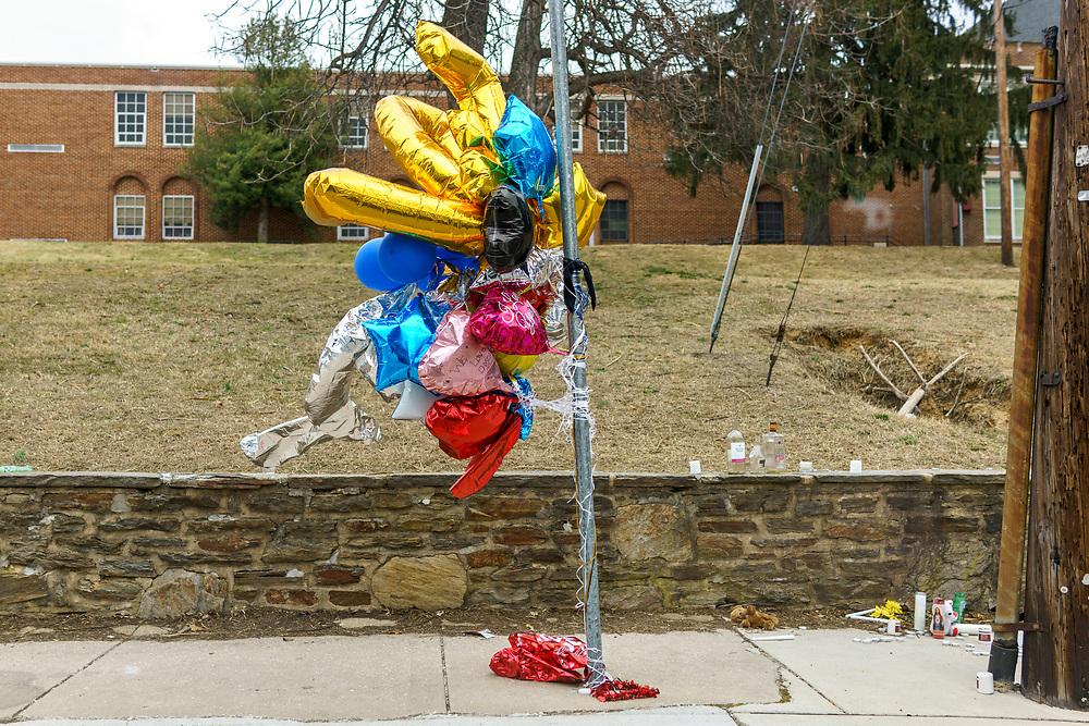 Baltimore, Maryland - February 05, 2017: Roadside memorial by Garrett Heights Elementary Middle School for a murder victim who died nearby.<br /> CREDIT: Matt Roth