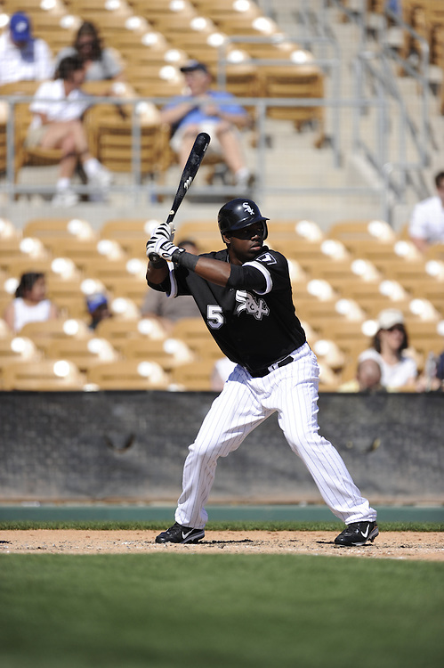 GLENDALE, AZ - MARCH 03:  Lastings Milledge #5 of the Chicago White Sox bats against the Seattle Mariners on March 03, 2011 at The Ballpark at Camelback Ranch in Glendale, Arizona. The White Sox defeated the Mariners 6-1.  (Photo by Ron Vesely)
