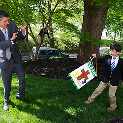 At the age of 9, John O'Leary was severely burned and not expected to live. Faith and prayer give him strength today as a husband and father of four, including Partick, 8, whom he photographed after his first communion while Henry, 6, climbed a tree at their home in Webster Groves.<br /> <br /> Teak Phillips | St. Louis Review | @TeakPhillips
