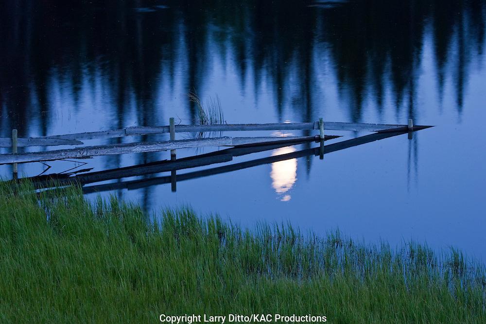 Moonrise over a British Columbia lake, Canada, June