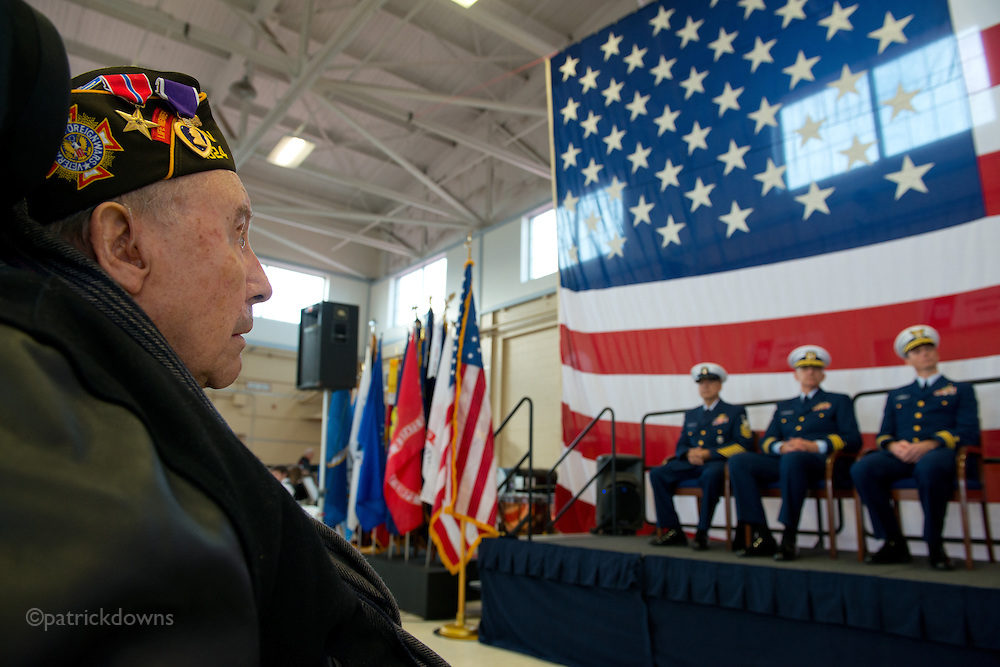 A WWII veteran listens to the speeches at the Veterans' Day ceremony at Coast Guard Station-Ediz Hook, in Port Angeles WA.
