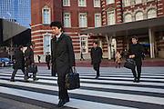 Salarymen on their way to work outside Tokyo station
