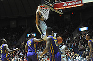 "Ole Miss' Sebastian Saiz (11) dunks against LSU's Jarell Martin (12) and LSU's Andre Stringer (10) at the C.M. ""Tad"" Smith Coliseum in Oxford, Miss. on Wednesday, January 15, 2013."