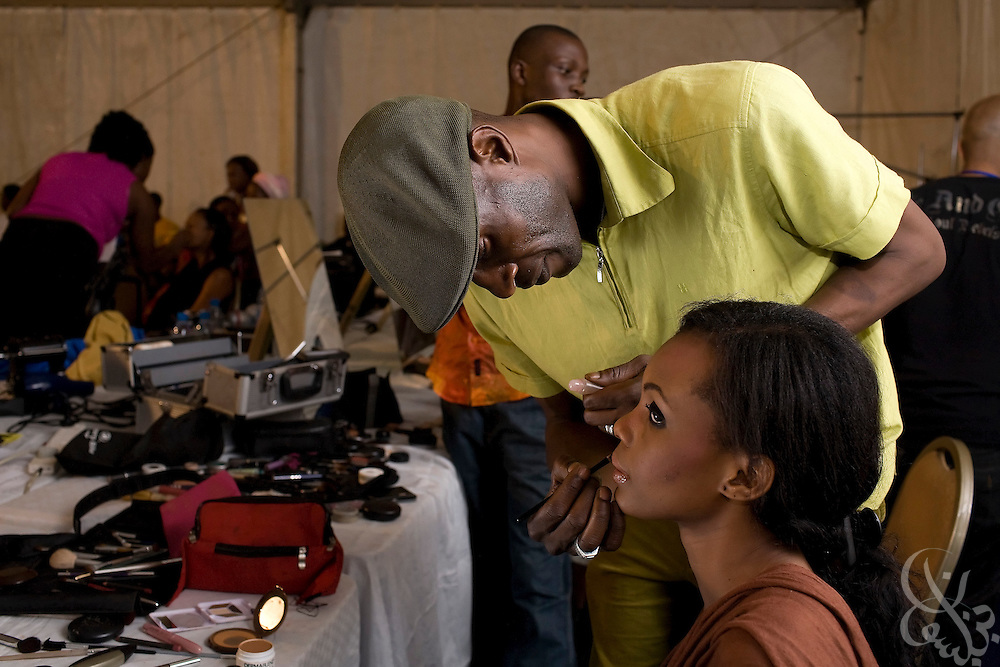 "Nigerian makeup artists and hair dressers work to prepare models for the fashion portion of the ThisDay festival July 13, 2008 in Lagos, Nigeria. The festival, themed ""Africa Rising"", aims to raise awareness of African issues while promoting positive images of Africa using music, fashion and culture in a series of concerts and events in Nigeria, the United States and the United Kingdom. ."