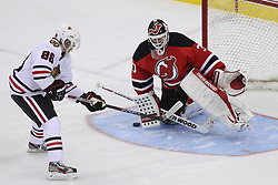 Mar 27; Newark, NJ, USA; New Jersey Devils goalie Martin Brodeur (30) makes a save on Chicago Blackhawks right wing Patrick Kane (88) during the overtime shootout at the Prudential Center. The Devils defeated the Blackhawks 2-1.