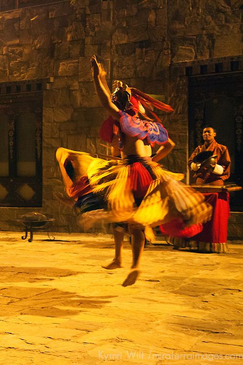 Asia, Bhutan, Thimpu. Traditional Bhutanese dancer at the Taj Tashi Hotel.
