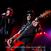 Velvet Revolver performing at The Nokia Theater on May 22, 2007. .Band members; .Scott Weiland ; Vocals.Slash ; lead guitar (top hat and sunglasses).Duff McKagan (bass, backing vocals, blonde with cowboy hat).Dave Kushner (rhythm guitar, bald)